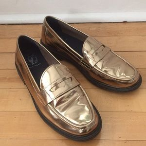 Cole Haan gold penny loafers